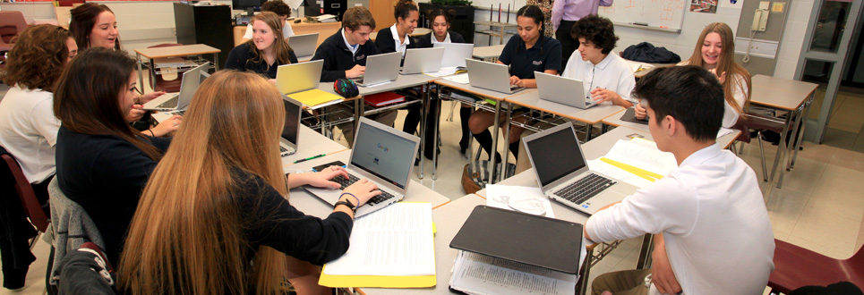 Students on laptops in a classroom