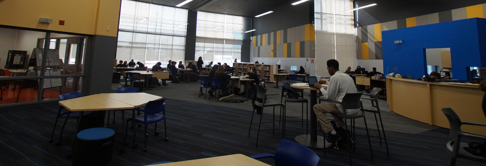 Students in the library learning commons area